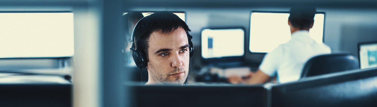 male-working-on-computer-with-headphones